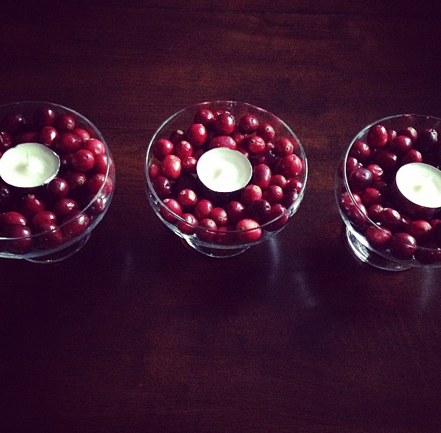 festive - and inexpensive - holiday decorating, with FOOD! Cranberries, tea light candles, and bowls from your cabinets.
